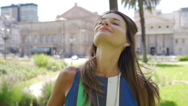 confident argentinian businesswoman on sunny day in park - 40 44 years stock videos & royalty-free footage