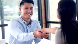 Confident business greets potential employee