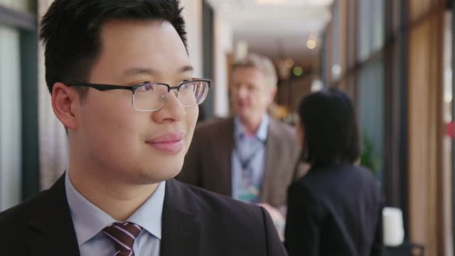 confident businessman at convention center - chinese ethnicity stock videos & royalty-free footage