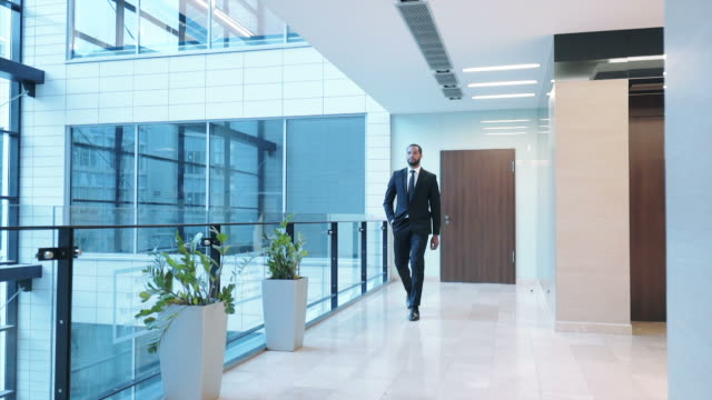 confident businessman going down the corridor. - ladder of success stock videos & royalty-free footage