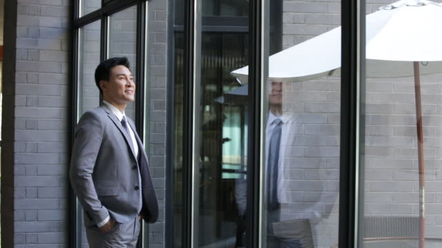 confident businessman looking through window,hd - full suit stock videos & royalty-free footage