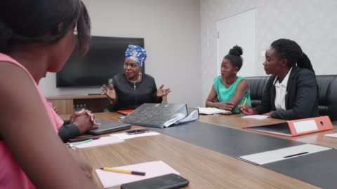 confident businesswoman chairing a staff meeting - africa stock videos & royalty-free footage