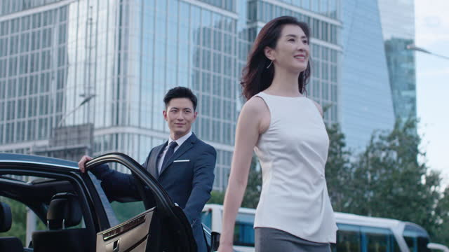 confident businesswoman getting out of car,4k - chauffeur stock videos & royalty-free footage