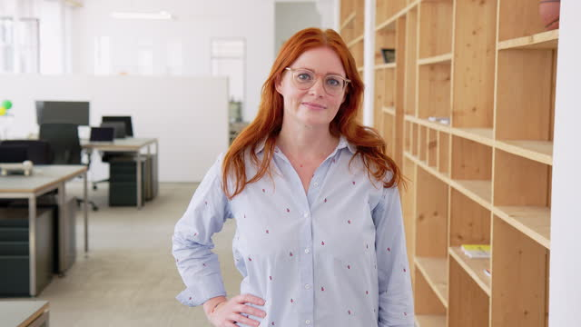 confident businesswoman in coworking office - button down shirt stock videos & royalty-free footage