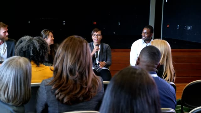 confident businesswoman participates in conference panel discussion - panel discussion stock videos & royalty-free footage