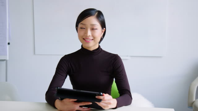 confident businesswoman sitting in board room - desk stock videos & royalty-free footage