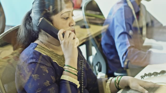 confident businesswoman talking on phone at office - indian ethnicity stock videos & royalty-free footage