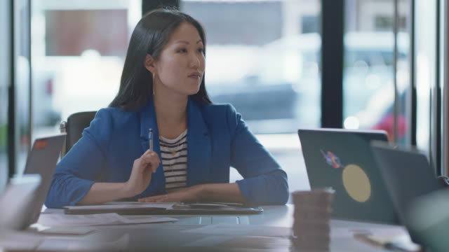 confident diverse business professionals brainstorm and discuss ideas together during a team meeting - white collar worker stock videos & royalty-free footage