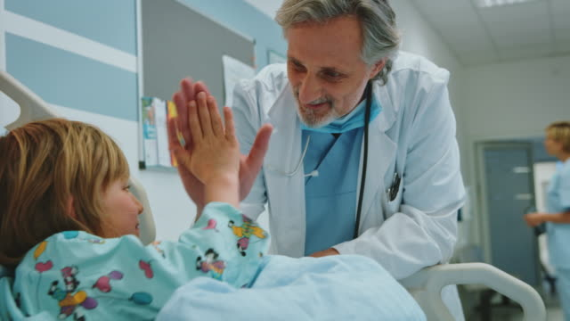 confident doctor visiting boy in emergency room - visit stock videos & royalty-free footage
