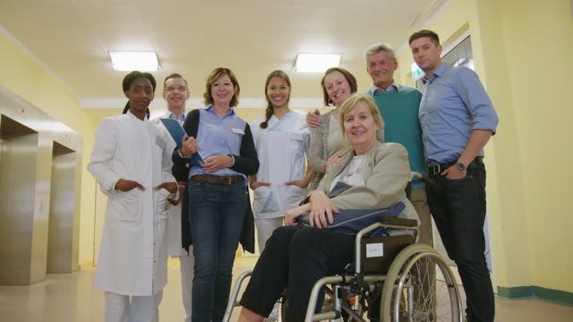 confident doctors with patients in hospital - disability stock videos & royalty-free footage