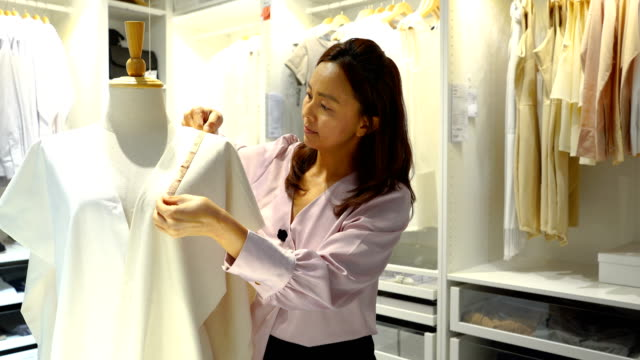 confident fashion designer working with dressmaker's model - haute couture stock videos and b-roll footage