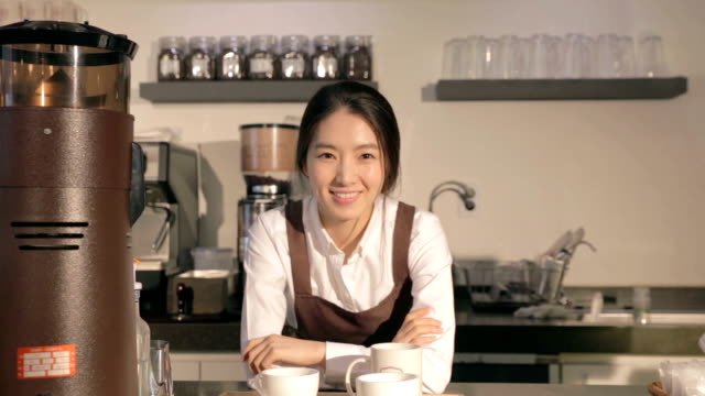 confident female barista in cafe - barista stock videos and b-roll footage