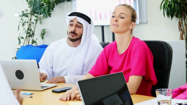 confident female business executive with an arab at their office - board room stock videos & royalty-free footage
