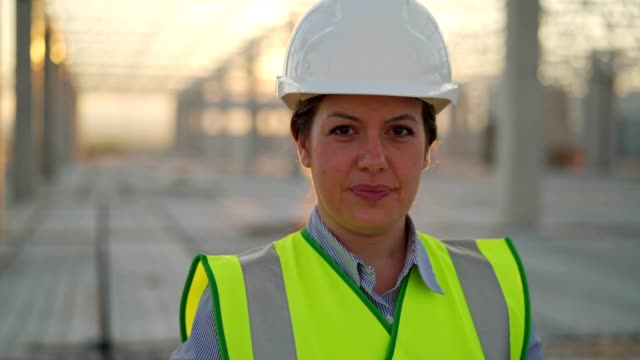 confident female construction engineer - hardhat stock videos & royalty-free footage