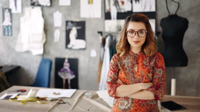 confident female dressmaker in her studio - eyeglasses stock videos & royalty-free footage