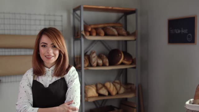 Confident Female Entrepreneur In Her New Bakery