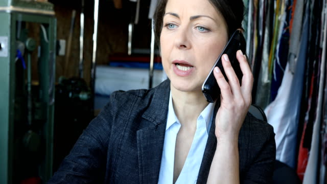 confident female manager talking on cordless phone - cordless phone stock videos & royalty-free footage