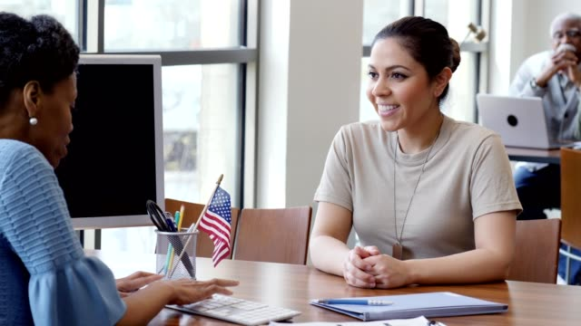 confident female soldier talks with loan officer - bank manager stock videos & royalty-free footage