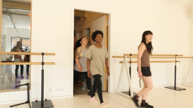 confident females entering dance studio - exercise class stock videos & royalty-free footage