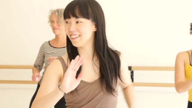 confident females learning dance at health club - east asian ethnicity stock videos & royalty-free footage