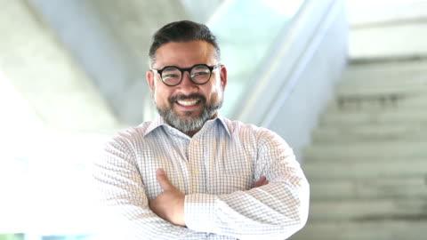 confident hispanic man wearing eyeglasses - button down shirt stock videos & royalty-free footage