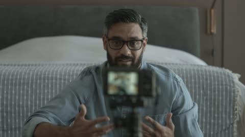 confident influencer talking while filming on camera - individualitet bildbanksvideor och videomaterial från bakom kulisserna