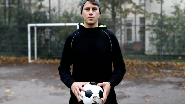 confident male athlete holding soccer ball - sportsperson stock videos & royalty-free footage