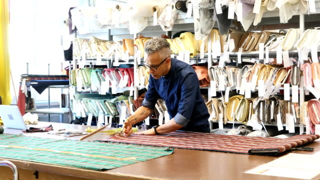confident male tailor cutting checked textile - design professional stock videos & royalty-free footage