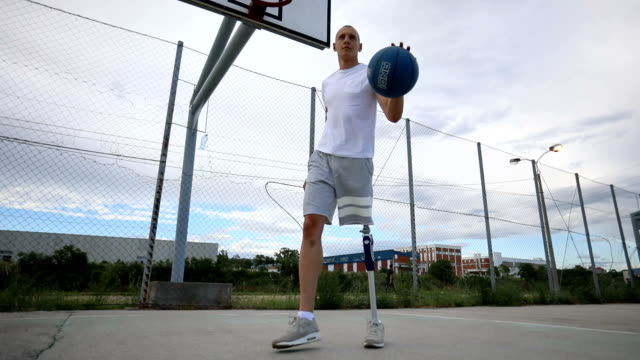 confident man with artificial leg playing basketball - artificial limb stock videos & royalty-free footage