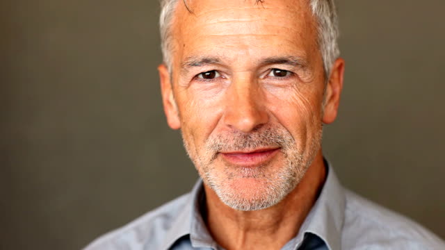 confident mature man smiling at you - close up stock videos & royalty-free footage