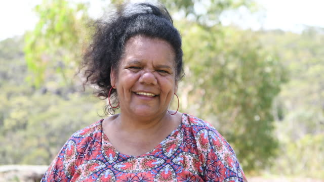confident mature woman smiling towards camera - aboriginal australian ethnicity stock videos & royalty-free footage