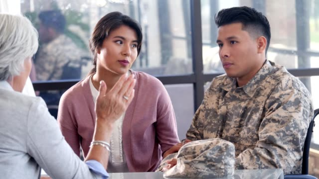 confident mental health professional gives advice to injured solider - paralysis stock videos & royalty-free footage