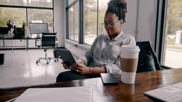 confident mid adult african american businesswoman taking a coffee break - lifestyle stock videos & royalty-free footage
