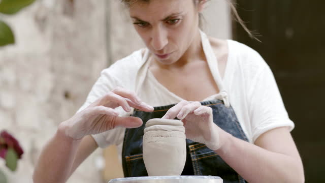 confident potter making clay bowl at workshop - pottery stock videos & royalty-free footage