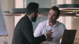 Confident salesman financial advisor explaining deal details to arabic client.
