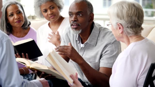 confident senior african american man facilitates book club in retirement community - organised group stock videos & royalty-free footage