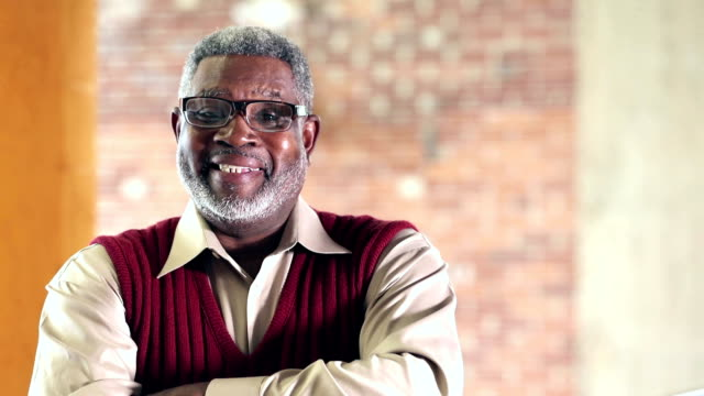 confident senior african-american man in sweater vest - hand on chin stock videos & royalty-free footage