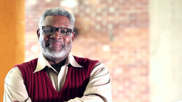 confident senior african-american man in sweater vest - saggezza video stock e b–roll