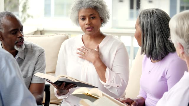confident senior woman discusses something during book club meeting - book club stock videos & royalty-free footage