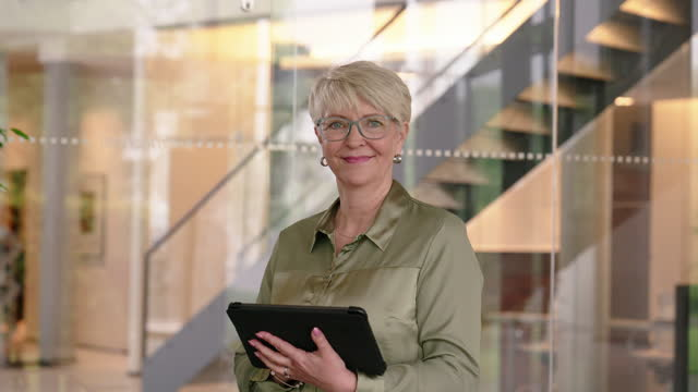confident senior woman with digital tablet in office - plain stock videos & royalty-free footage