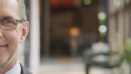 Confident smiling businessman at seminar in hotel