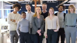 Confident team standing together in office