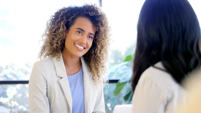 confident therapist advises female patient - job interview stock videos & royalty-free footage