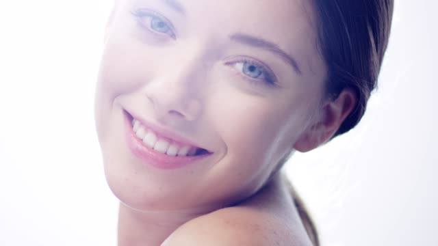 confident woman looking at camera. face skin care. lens flares - beautiful woman stock videos & royalty-free footage