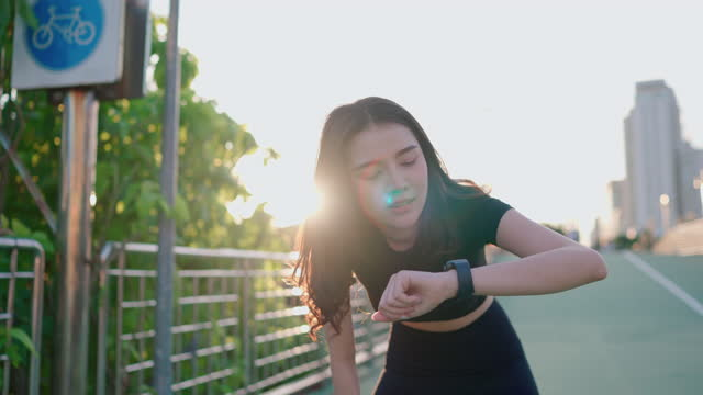 confident woman runner checking her smart watch after run - smart watch stock videos & royalty-free footage