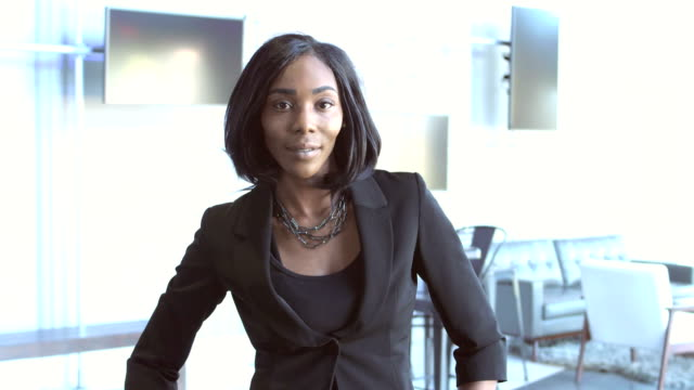 confident young african-american businesswoman - hand on hip stock videos & royalty-free footage
