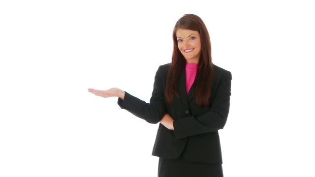 Confident young businesswoman standing against white background