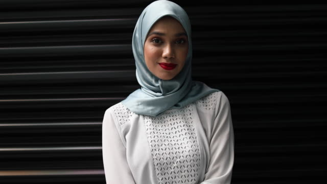 confident young muslim woman - cultura malesiana video stock e b–roll