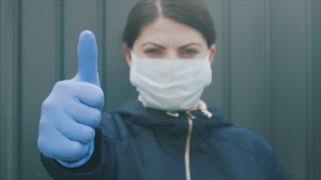 confident young woman during pandemic period. - hope stock videos & royalty-free footage