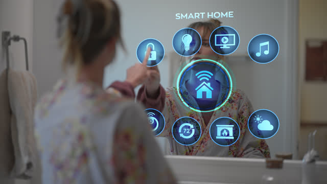 confident young woman locks her home using her smart mirror - tapping stock videos & royalty-free footage